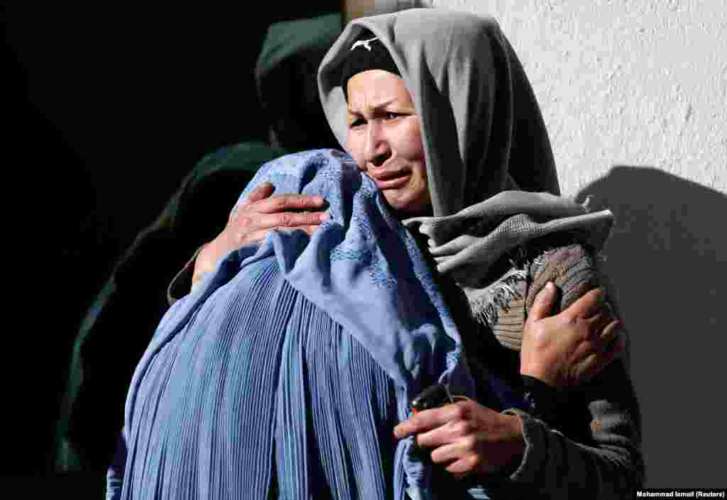 Afghan women mourn inside a hospital compound after a suicide attack in Kabul killed at least 40 people at a Shi'ite cultural center on December 28. (Reuters/Mohammad Ismail)