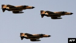 "FILE PHOTO - Vietnam-era F-4 ""Phantom"" fighter jets fly during an annual military parade which marks Iran's eight-year war with Iraq, in Tehran, Sep. 22 2009"