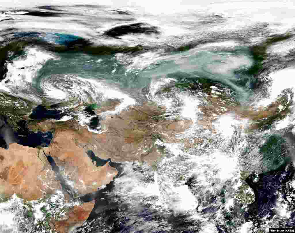 Images taken by NASA on July 23 show a plume of smoke (top right) above central Siberia that is bigger than most countries.