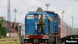Тіла загиблих в авіакатастрофі на Донеччині до Харкова доставили спецпецпотягом, 22 липня 2014