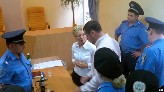 Former Prime Minister Yulia Tymoshenko (center) attends a session of Kyiv's Pecherskiy district court on August 5.