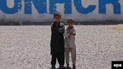 Пакистандагы ооган качкындарынын балдары. 2014-жыл.
