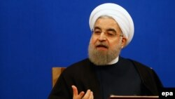 """They have forgotten that the Berlin Wall collapsed many years ago,"" Iranian President Hassan Rohani said."