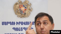 Armen Harutiunian, the state human rights ombudsman, at a news conference in Yerevan on July 7.