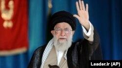 Iranian Supreme Leader Ayatollah Ali Khamenei waves to thousands of members of the Basij at Azadi stadium in Tehran on October 4.