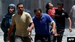 فلسطینیها در حال فرار از خانههای خود در شجاعیه