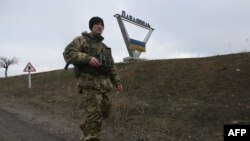 A Ukrainian serviceman on patrol in the Donetsk region (file photo)