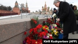 Politician Grigory Yavlinsky lays flowers at the site where Boris Nemtsov was killed on the fourth anniversary of his death on February 27.