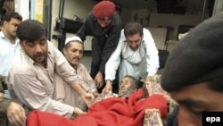 An injured man is taken into a hospital in Peshawar after a suicide bomber struck a military convoy. At least 41 people were killed in the attack.