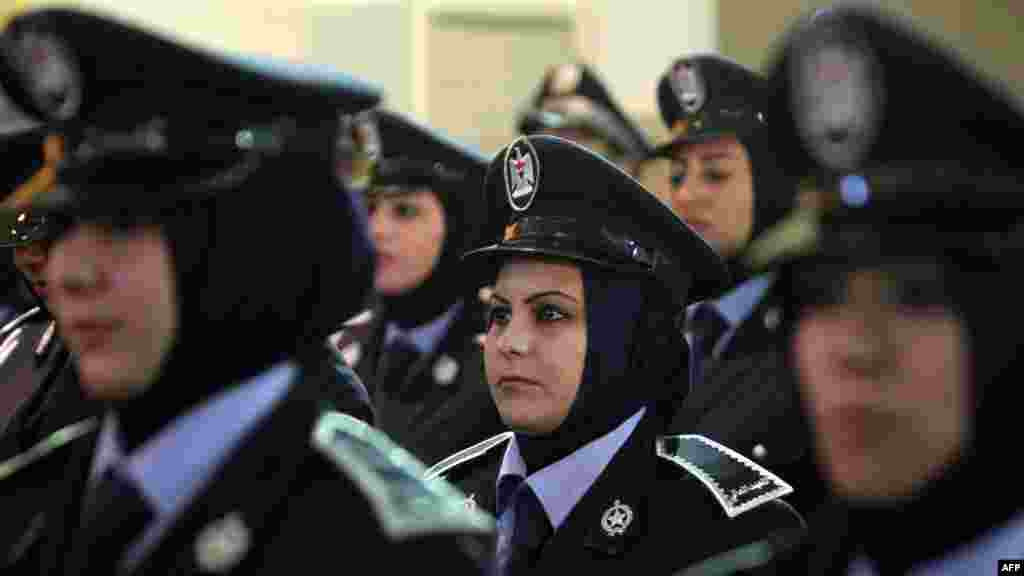 Women police officers in Baghdad attend celebrations marking the 91st anniversary of the founding of the country's police. (AFP/Ahmad Al-Rubaye)