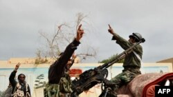 Rebels in Ras Lanuf celebrate on March 5 the taking of that port city from Qaddafi forces one day earlier.
