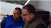 A video appears to show billionaire Oleg Deripaska (left) and Russian Deputy Prime Minister Sergei Prikhodko meeting on board the tycoon's yacht.