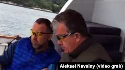 Oleg Deripaska (left) and Sergei Prikhodko are shown allegedly on board the business tycoon's yacht in the video.