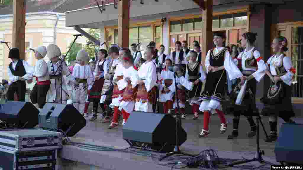 A children's folklore group performs a traditional Serbian dance.