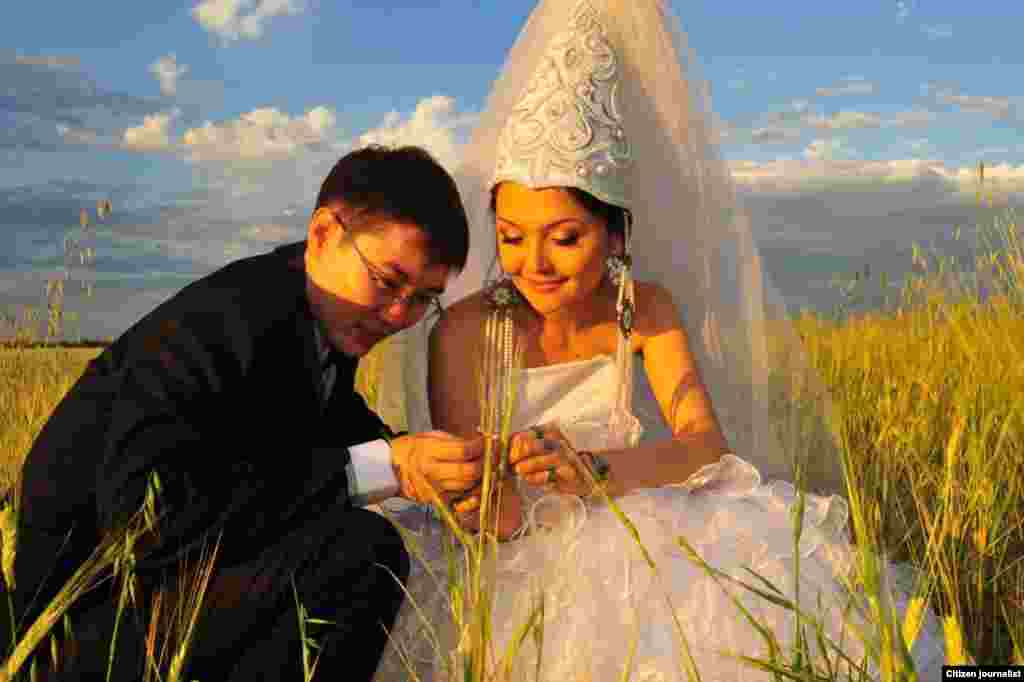A bride wearing a traditional Kazakh wedding outfit.