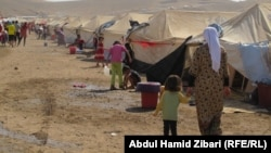 لاجئون سوريون في مخيم قرب أربيل