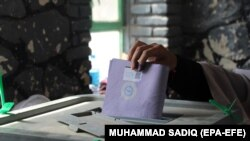 AFGHANISTAN -- An Afghan man casts his vote during the Parliamentary elections in Kandahar, Afghanistan, 27 October 2018.