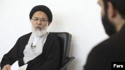 محمدمهدی میرباقری (سمت چپ)