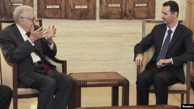 Syrian President Bashar al-Assad (right) with UN-Arab-League peace envoy for Syria Lakhdar Brahimi (file photo)