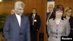 EU foreign policy chief Catherine Ashton (right) greets Iran's chief nuclear negotiator Said Jalili (left) in Geneva.