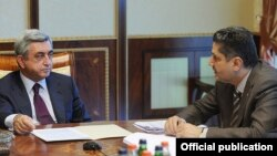 Armenia - President Serzh Sarkisian (L) and Prime Minister Tigran Sarkisian at a government meeting in Yerevan.