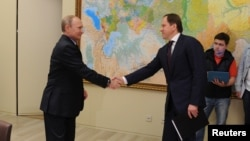 Russia's Minister for North Caucasus Affairs Lev Kuznetzov (right), seen here meeting with President Vladimir Putin, has said that the region's development plan will shift from alleviating social problems to focusing on attracting investment.