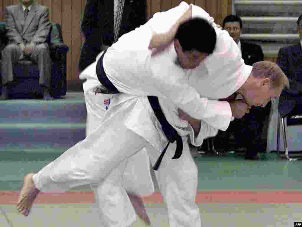 Putin throws a Japanese judo expert during an exhibition in Tokyo in September 2000.