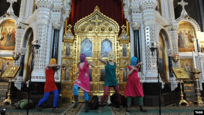 Russia -- Members of Pussy Riot sing a protest song against Vladimir Putin and the support of the Orthodox Church for him in Moscow'as main cathedral.
