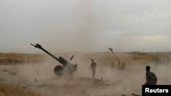 Afghan National Army soldiers fire artillery during a battle with Taliban insurgents in Kunduz on April 29.