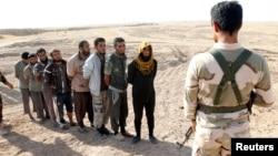 Kurdish Peshmerga forces detain Islamic State militants southwest of Kirkuk in October 2017.