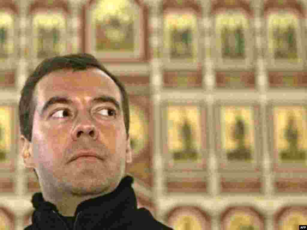 The Devotee - Medvedev was christened into the Russian Orthodox Church at the age of 23, an event he describes as a life-changing experience. He receives significant support from the church and its head, Patriarch Aleksy II. In 2007, a government commission headed by Medvedev approved a program for the restitution of property and assets taken from the church after the Bolshevik Revolution.