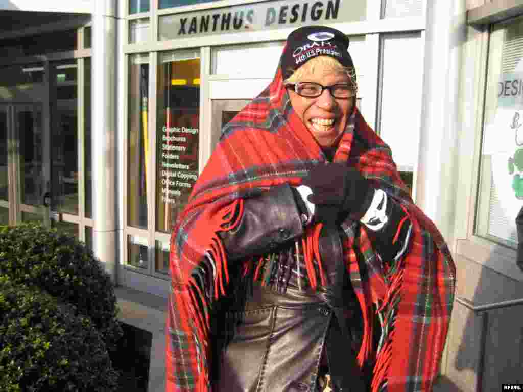Spectators, like Yvonne Jones from Lexington, Kentucky, struggled to keep warm in freezing weather. - obama20 photo by Ricki Green
