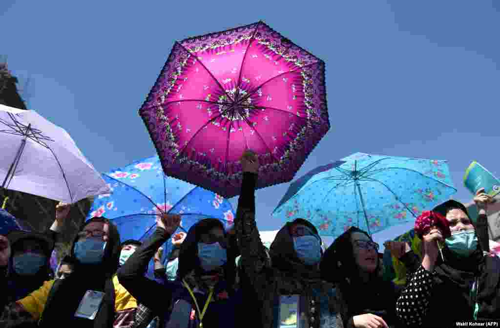 Afghan Hazara protesters chant antigovernment slogans during a demonstration in Kabul on May 16. (AFP/Wakil Kohsar)