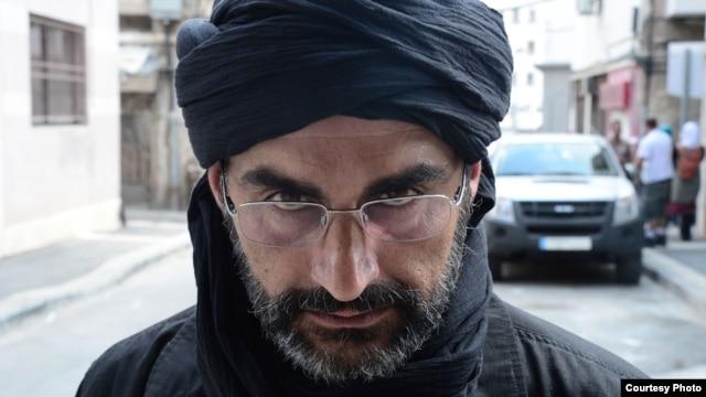 Navid Negahban in character