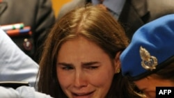 Amanda Knox reacts emotionally to the announcement of her acquittal at an appeal hearing in the Meredith Kercher murder case in Perugia.