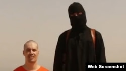Syria -- (DISCRETION ADVISED) grab from 'Islamic State' (formerly ISIS/ISIL) video that appeared 19aug2014 showing beheading of captive believed to be US photojournalist James Wright Foley