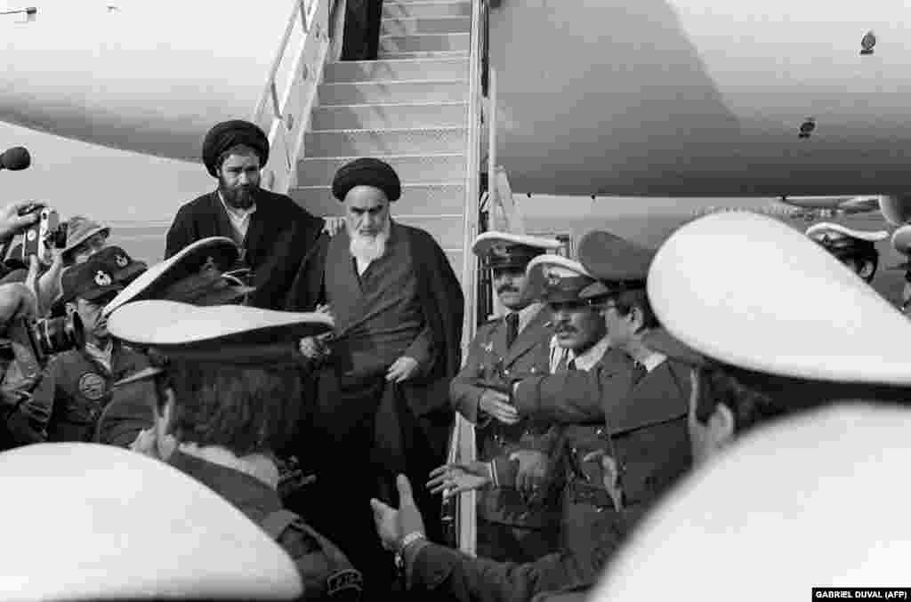 Ayatollah Ruhollah Khomeini arrives in Tehran on February 1, 1979. Some 120 journalists accompanied him on the flight from Paris. Although Iran's U.S.-backed Shah had already fled the country, Khomeini's return from exile is often seen as the true start of Iran's Islamic revolution.