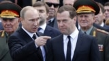 "Russian President Vladimir Putin (left) to former Prime Minister Dmitry Medvedev: ""I'm tired, you're going."""