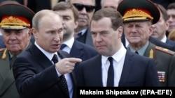 """Russian President Vladimir Putin (left) to former Prime Minister Dmitry Medvedev: """"I'm tired, you're going."""""""