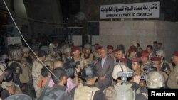 وزير الدفاع عبد القادر العبيدي يتحدث للصحفيين بعد عملية إقتحام الكنيسة