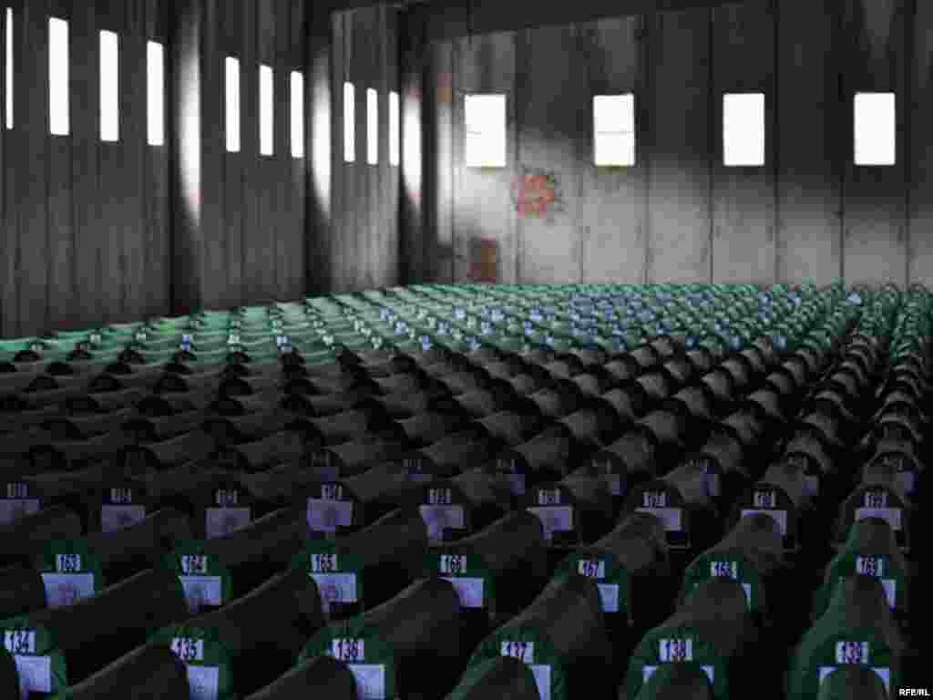 Coffins of newly identified victims of the 1995 Srebrenica massacre await burial at the Potocari memorial cemetery near Srebrenica on July 10, 2010.