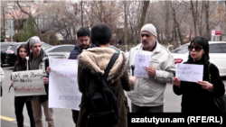 Armenian supporters of jailed Iranian rights lawyer Nasrin Sotoudeh gather outside Iran's Embassy in Yerevan on March 19 to call for her release.