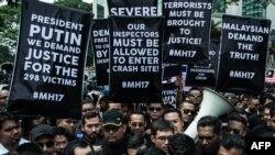 В Куала-Лумпуре вскоре после катастрофы рейса MH17 состоялись массовые демонстрации с требованием расследовать гибель лайнера