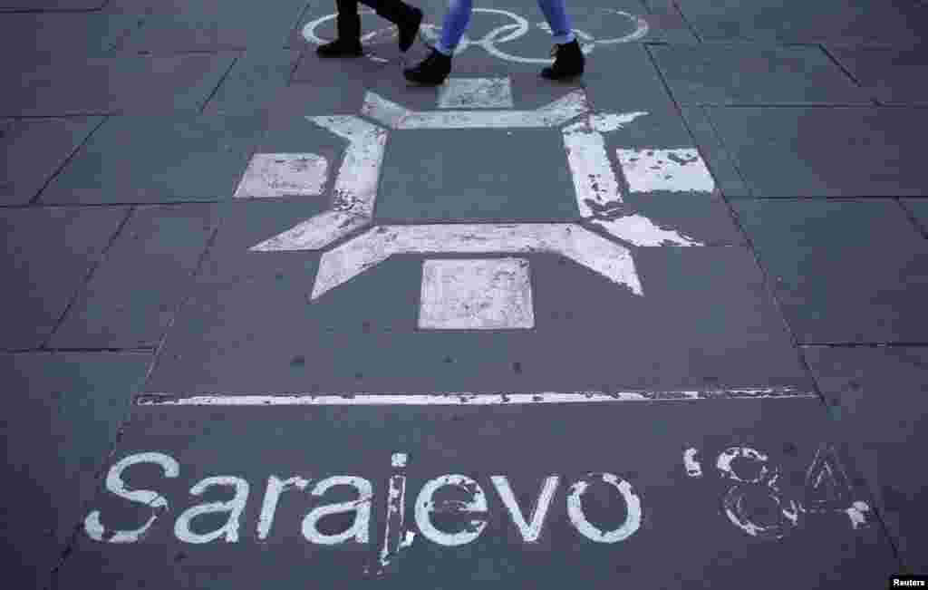 Another timeworn Olympic logo on a street in central Sarajevo