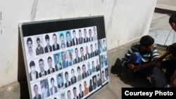 A board in the southern Kyrgyz city of Osh displays pictures of ethnic Uzbek men killed during the ethnic clashes in June.