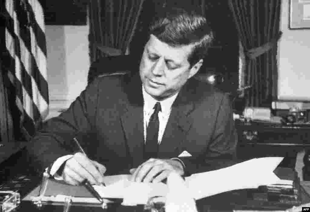 With U.S. military forces at alert posture DEFCON 2 for the only time in U.S. history, President Kennedy signs an order on October 24 for a naval blockade of Cuba.