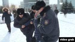Kazakh police detain protesters in Astana amid antigovernment rallies across the country last month.
