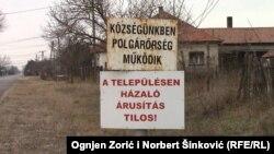 """Tabla na kojoj piše """"Našu opštinu čuva civilna straža"""""""