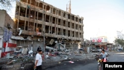 Pamje pas një sulmi të mëparshëm në Bagdad