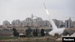An Iron Dome launcher fires an interceptor rocket near the Israeli city of Ashkelon on November 19.